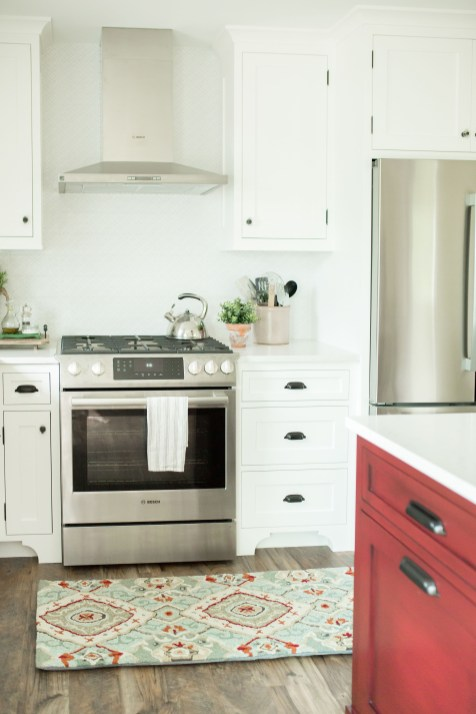 white kitchen with red island