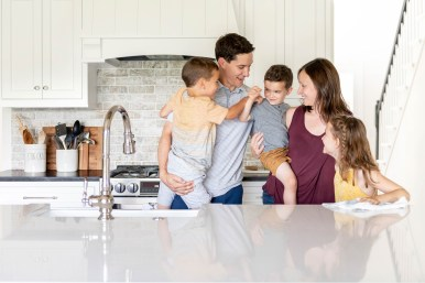 Family in their new kitchen remodel