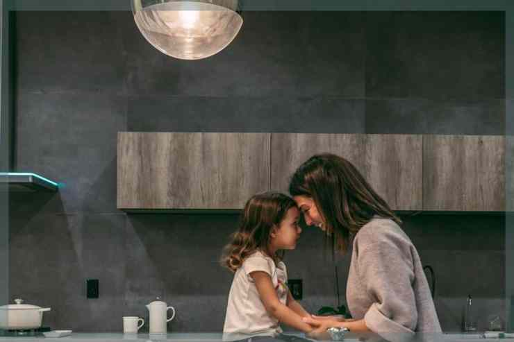 Photo of mom and daughter with the best kitchen countertops for families
