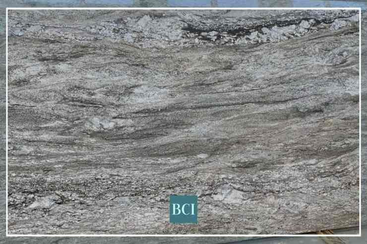 Photo of black and grey granite slab. Granite is one of the most popular types of stone countertops.
