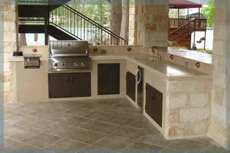 Photo of outdoor kitchen with travertine countertops. Travertine is one of the most classic types of stone countertops.