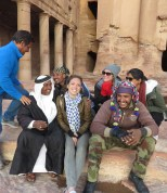 Pure smiles with other tourists and bedouins during sunset at Petra - Anika Mikkelson - Miss Maps - www.MissMaps.com