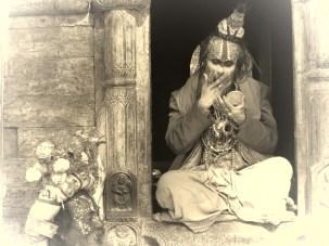 A Sadhu Man takes a break to apply his makeup - Pashupati Nepal - by Anika Mikkelson - Miss Maps