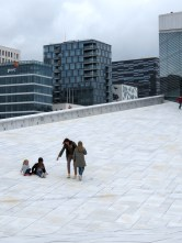 Sliding down the roof of Oslo's Opera House - Oslo, Norway - by Anika Mikkelson - Miss Maps