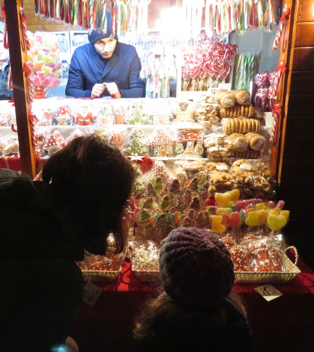 Window shopping for gingerbread cookies at Bucharest's Christmas Market - - Bucharest Romania - by Anika Mikkelson - Miss Maps - www.MissMaps.com