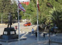 A Turkish Flag and a Cypriot Turkish Flag fly side by side in North Nicosia - by Anika Mikkelson - Miss Maps - www.MissMaps.com