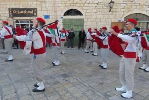 Bagpipes in Bethlehem Playing Christmas Carols - by Anika Mikkelson - Miss Maps - www.MissMaps.com