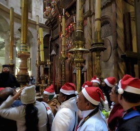 Christmas Day visitors wait to enter the aedicula, containing the tomb of Jesus, Church of the Holy Sepulchre in Old City Jerusalem - by Anika Mikkelson - Miss Maps - www.MissMaps.com