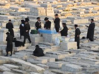 Jews praying in Mount of Olives Cemetery - Jerusalem, Israel - by Anika Mikkelson - Miss Maps - www.MissMaps.com