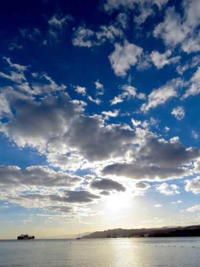 Sun and Clouds and the Red Sea, as seen from Eilat Israel - by Anika Mikkelson - Miss Maps - www.MissMaps.com