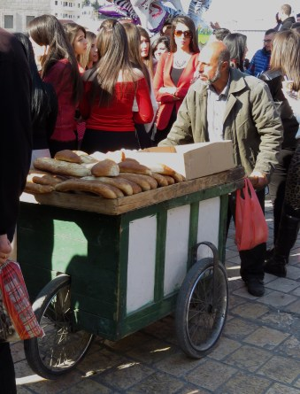 The Vendor who sold us lunch rolling through the streets of Bethlehem - by Anika Mikkelson - Miss Maps- www.MissMaps.com