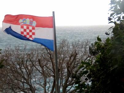 Croatia's Flag flying high above the Adriatic Sea - Dubrovnik, Croatia - by Anika Mikkelson - Miss Maps - www.MissMaps.com