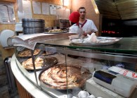 Inside Sac - serving traditional Burek and other filled pita pastries cooked over coals - Sarajevo, Bosnia and Herzegovina - BiH - by Anika Mikkelson - Miss Maps - www.MissMaps.com
