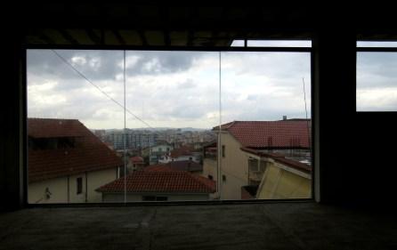 Tirana Albania from a deserted building - by Anika Mikkelson - Miss Maps - www.MissMaps.com
