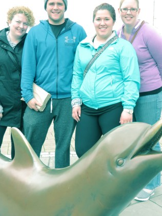 Posing in front of Dingle's Famous Dolphin - Dingle Ireland - by Anika Mikkelson - Miss Maps - www.MissMaps.com