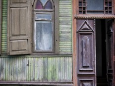 Close up of an entryway to an old wooden home - Villnius Lithuania - by Anika Mikkelson - Miss Maps - www.MissMaps.com