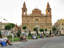 Couples in front of Church of Msida - Malta - by Anika Mikkelson - Miss Maps - www.MissMaps.com