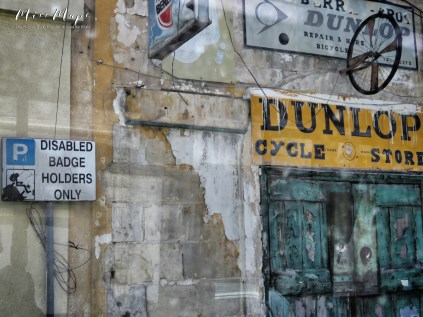 Views from the bus - Dunlop Cycle Store - Malta - by Anika Mikkelson - Miss Maps - www.MissMaps.com