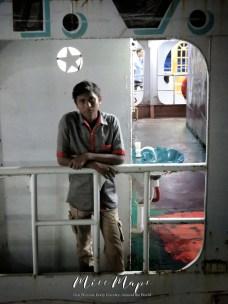 Boy on the boat across from me - Dhaka to Sundarbans Bangladesh - by Anika Mikkelson - Miss Maps - www.MissMaps.com