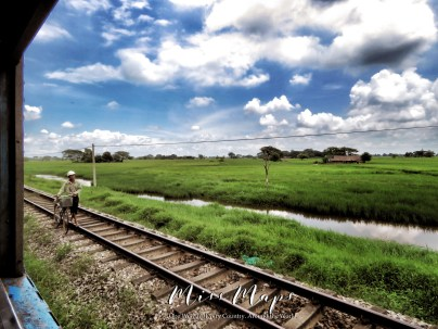 Seller on the Railroad Tracks to Bago Myanmar - October 2016