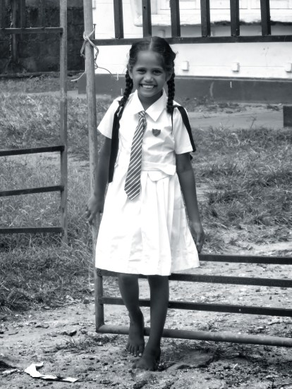 A beautiful smiling schoolgirl - Galle Sri Lanka - by Anika Mikkelson - Miss Maps - www.MissMaps.com