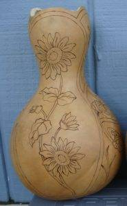 Curvy lines surround the gourd design