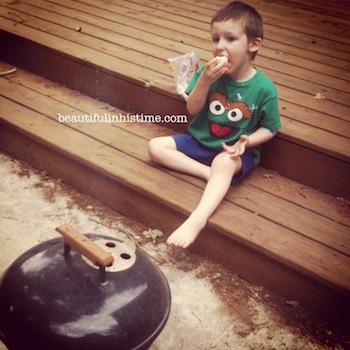15 little boy eating marshmallows