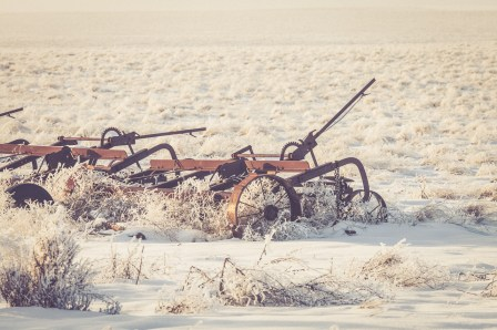 Vintage farm equipment abandoned at the edge of a field in eastern Washington