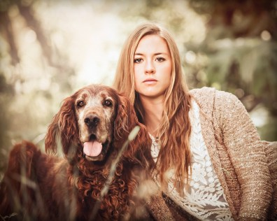 Beautiful girl with her beautiful Irish Setter dog