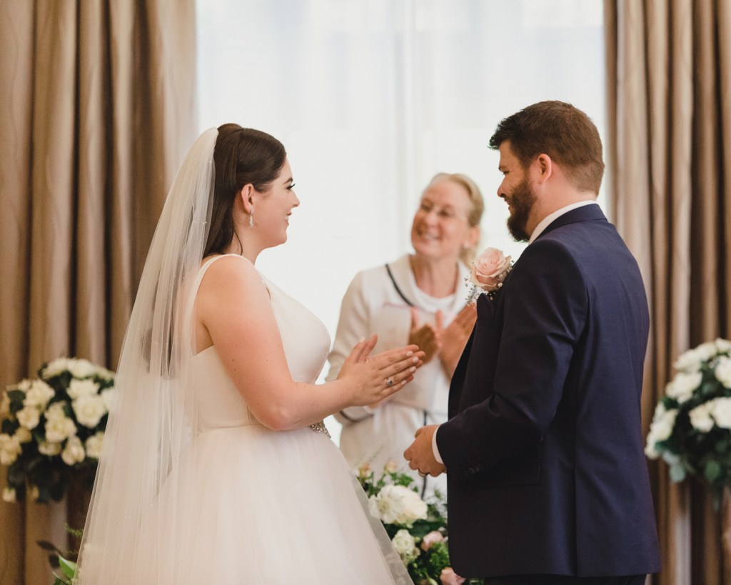 Bride claps her hands with joy on being pronounced married