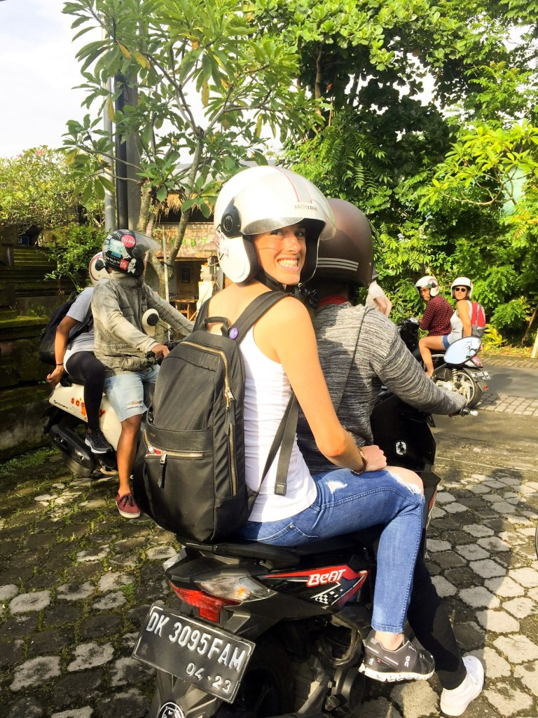 Empowered woman from South Africa enjoys Ubud Bali motorbike tour.