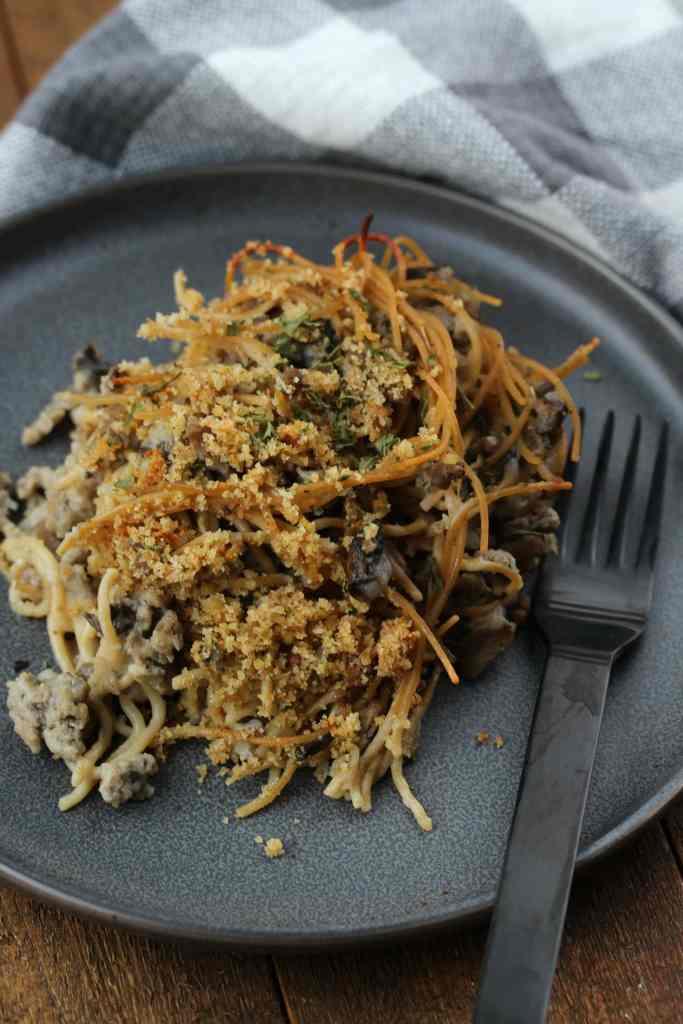 Serving of Turkey Tetrazzini Casserole on a gray plate.