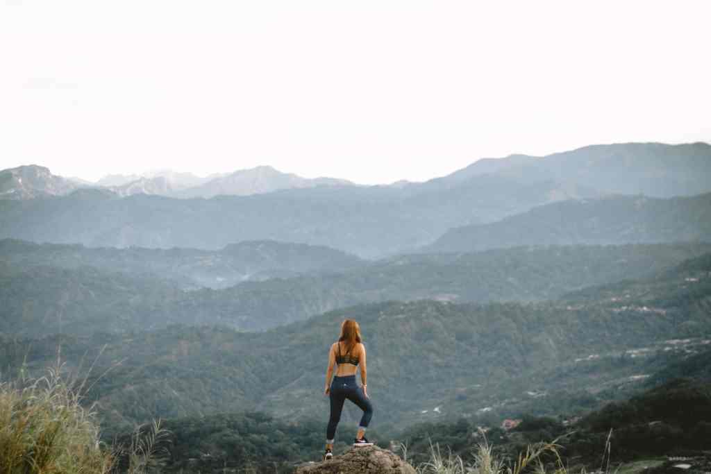 woman standing on a mountain