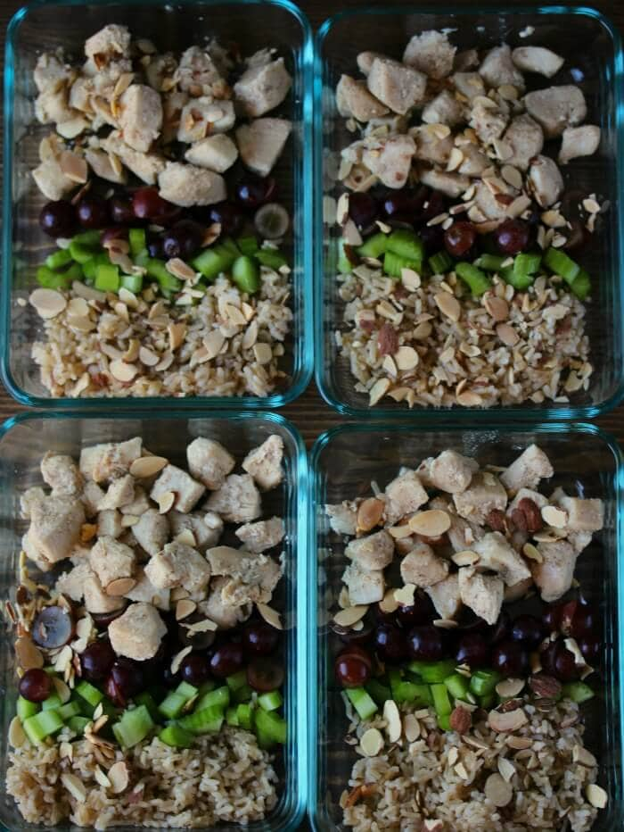 Overhead view of four containers of Chicken Salad and Brown Rice Bowls