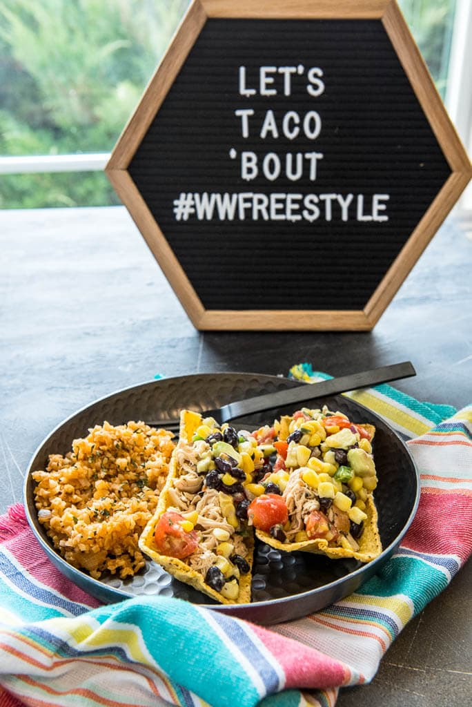 Sign with Let's Taco 'Bout #wwfreestyle and a plate with 2 Chicken Tacos and Healthy Mexican Cauliflower Rice