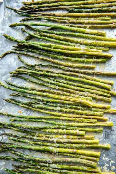 Fresh asparagus drizzled with olive oil and garlic and roasted with fresh parmesan cheese is a healthy and easy vegetable to accompany your favorite entree!