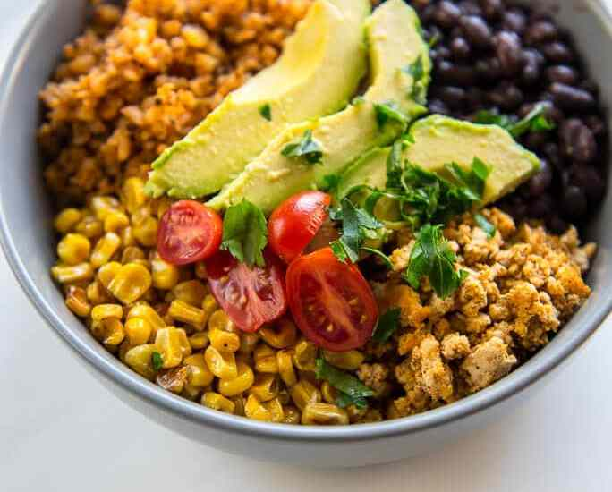Turkey Taco Bowls with Cauliflower Rice is a healthy low-carb meal that is quick and easy to prepare and makes great leftovers! #turkey #groundturkey #blackbeans #cauliflowerrice #cauliflower #lowcarb #wholefoods #healthyrecipe #cleaneating