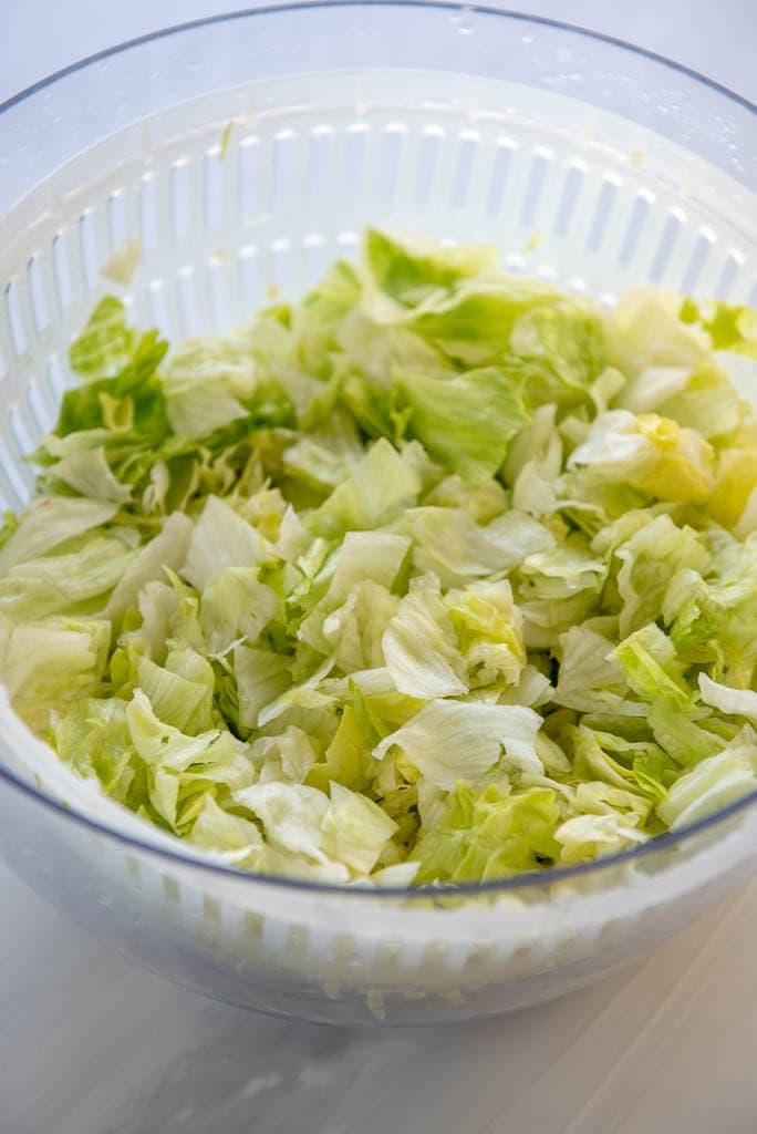Overhead view of lettuce in a salad spinner