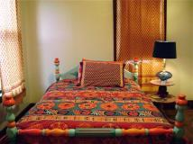 moroccan-style-bedding-lime-green-wall-typical-motive-bed-sheet-motives-curtains-black-sitting-lamp-colorful-bed-frame-wooden-floor-moroccan-style-bedding-red-orange-wall-typical-motive-sofa