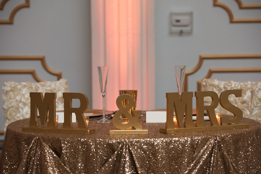 Wedding Reception Sweetheart Table Decor with Mr and Mrs Wedding Letters and Gold Glittery Sequined Table Linen
