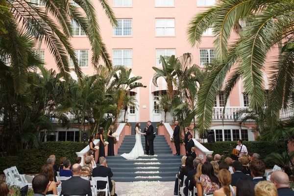 Bride and Groom Exchanging Vows | Outdoor St Pete Beach Wedding Ceremony at Loews Don CeSar