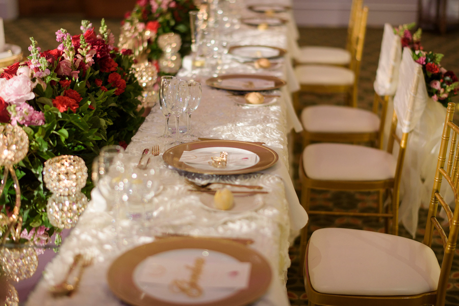 Peta-&-Dave-marriott-wedding-reception-styling-ivory-linens-gold-diamante-candle-holder-fresh-flower-florals-bridal-table-charger-plates