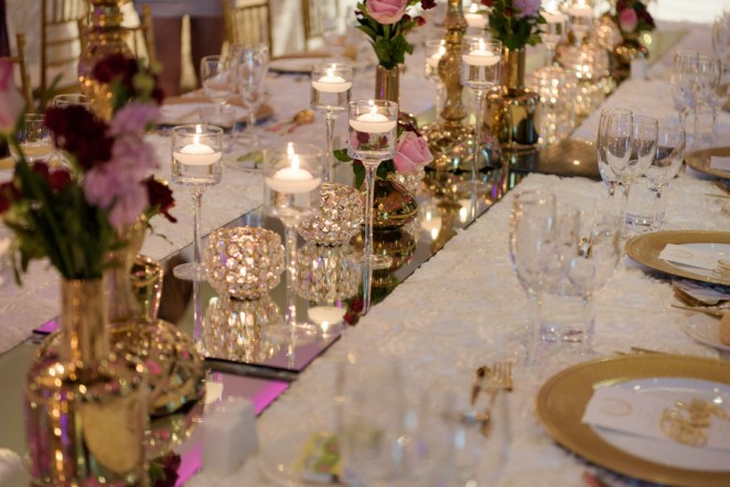Peta-&-Dave-marriott-wedding-reception-styling-white-gold-vases-fresh-flower-florals-floating-candles-guest-table-centrepiece