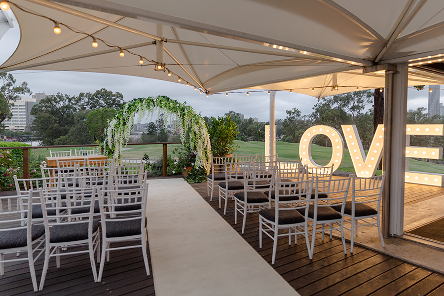 Victoria-Park-garden-marquee-deck-ceremony-circle-greenery-wisteria-arch-white-carpet