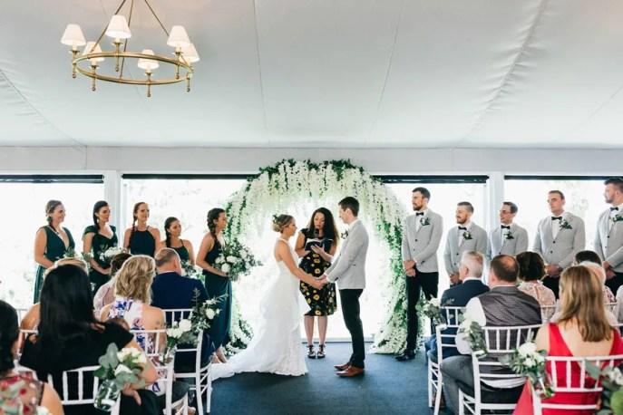 Tara-&-Sean-Victoria-Park-garden-marquee-indoor-ceremony-circle-greenery-wisteria-arch