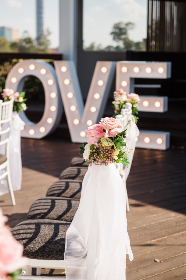 teresa-&-esmond-victoria-park-marquee-deck-arbour-wedding-ceremony-styling-draping-aisle-chair-fresh-flowers-florals-event-letters-love