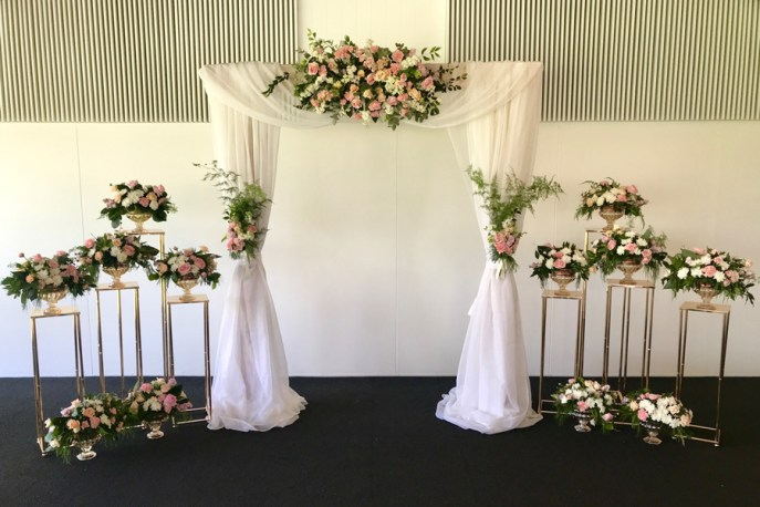 Victoria-Park-garden-marquee-indoor-ceremony-timber-arch-gold-stand-florals