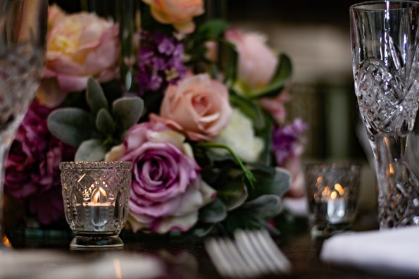 blackbird-wedding-reception-styling-clear-crystal-cut-stemware-glassware-tealights-faux-silk-flower-floral-centrepiece