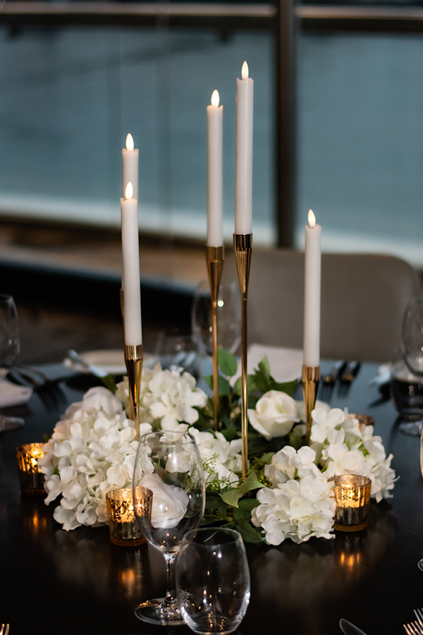 blackbird-wedding-reception-styling-gold-candelabra-candlestick-holder-guest-table-centrepiece-faux-silk-flower-florals-gold-tealights