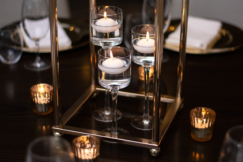 blackbird-wedding-reception-styling-gold-stand-table-centrepiece-floating-candles-gold-tealights